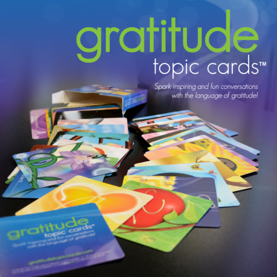"Image of colorful, 3.5""x3.5"" glossy cards spilled onto a table. Shows the variety of cards in the GTC deck."